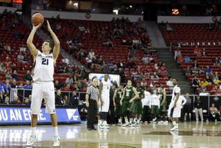 Utah State's Spencer Butterfield shoots a free throw after a technical foul on Daniel Bejarano during the second half of a Mountain West Conference tournament NCAA college basketball game Wednesday, March 12, 2014, in Las Vegas. Utah State defeated Colorado State 73-69. (AP Photo/Isaac Brekken)