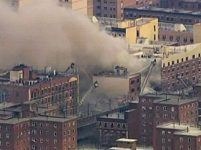 In this image taken from video from WABC, firefighters battle a blaze at the site of a possible explosion and building collapse in the East Harlem neighborhood of New York, Wednesday, March 12, 2014.