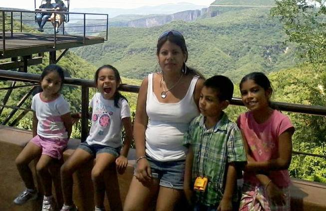 "Sandra Ramos poses with her four children in an undated photo. Ramos plans to cross the border from Tijuana to San Diego on March 13, 2014, as part of the ""Bring Them Home"" event in which more than 30 immigrants without approval will cross into the United States seeking residency or asylum. Three of Ramos' four children are U.S. citizens."