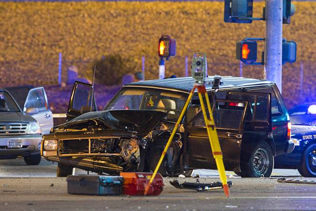 A vehicle is shown after a shooting victim was involved in an accident at the 1-215 eastbound off-ramp at Eastern Avenue Thursday, March 13, 2014. The driver, who had been shot multiple times, may have been shot at another location, police said.