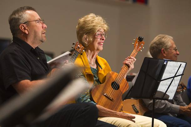 Doug Parsons, left, of Melbourne, Fla., and Marlene Phillips attend a meet up of the Las Vegas Ukulele Club at the Las Vegas Church of the Nazarene Thursday, March 13, 2014. The club meets every Thursday.