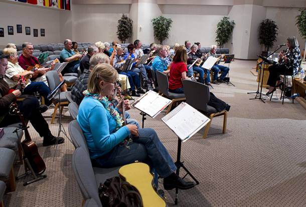 Founder Lynn Weaver, right, leads a meeting of the Las Vegas Ukulele Club at the Las Vegas Church of the Nazarene Thursday, March 13, 2014. The club meets every Thursday.