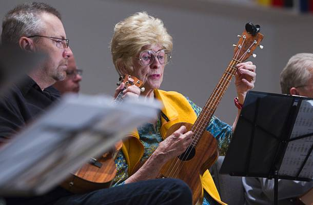 Doug Parsons, left, of Melbourne, Fla., and Marlene Phillips play during a meet up of the Las Vegas Ukulele Club at the Las Vegas Church of the Nazarene Thursday, March 13, 2014. The club meets every Thursday.