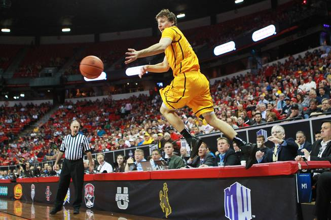 Wyoming guard Riley Grabau leaps as he tries to keep the ball inbounds during their Mountain West Conference tournament game against UNLV Thursday, March 13, 2014 at the Thomas & Mack Center.