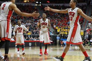 UNLV's Khem Birch, Deville Smith, Roscoe Smith and Bryce Dejean-Jones celebrate an and-one against Wyoming during their Mountain West Conference tournament game Thursday, March 13, 2014, at the Thomas & Mack Center. UNLV won the game 71-67.