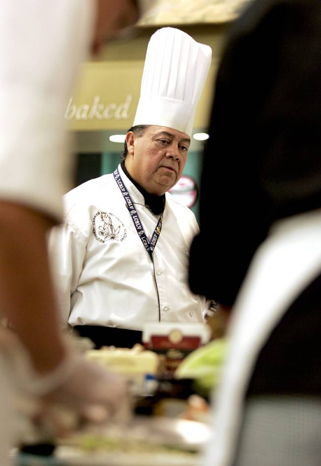 Chef Instructor Ruben Munoz Jr. observes the work of his Southwest Career and Technical Academy students with the Culinary Collision at the Whole Foods Market in Town Square on Thursday, March 13, 2014.