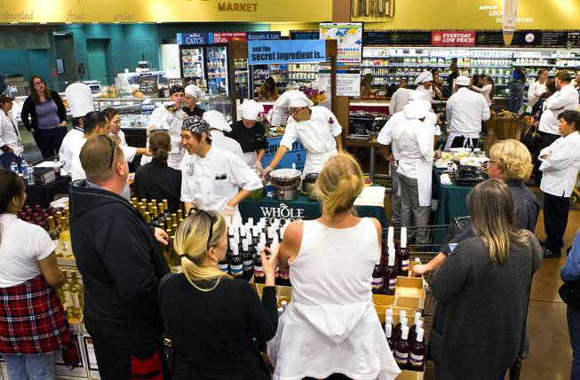 Family members and supporters watch as students prepare their selected meals during the Culinary Collision at the Whole Foods Market in Town Square on Thursday, March 13, 2014.