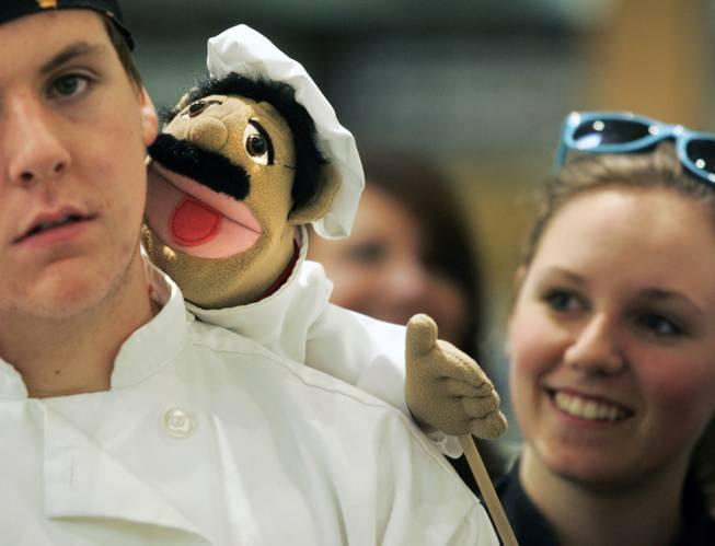 Student William Buchberger has Francois the puppet on his shoulder during the Culinary Collision at the Whole Foods Market in Town Square on Thursday, March 13, 2014.