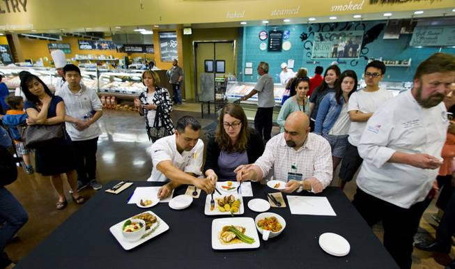 The Culinary Collision judges chef Lloyd Bansil, Rachel Safran and Raffi Ghanimian taste the finished meals to be rated during the competition at the Whole Foods Market in Town Square on Thursday, March 13, 2014.
