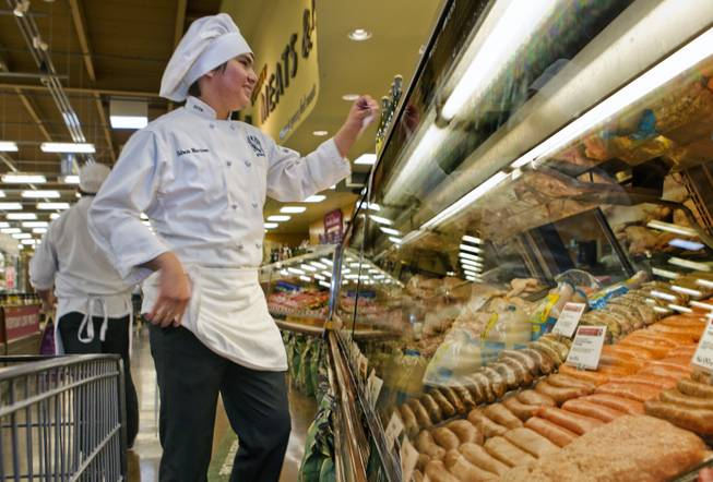 Student Edwin Martinez of the East Career and Technical Academy orders at the meat counter for his team during the Culinary Collision at the Whole Foods Market in Town Square on Thursday, March 13, 2014.