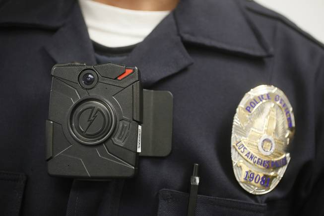 A Los Angeles Police officer is shown with an on-body camera during a demonstration for media in Los Angeles, Jan. 15, 2014. Thousands of police agencies have equipped officers with cameras on their uniforms, but they've frequently lagged in setting policies on how they're used.