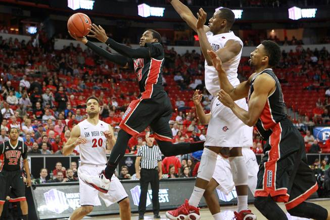 UNLV guard Deville Smith drives to the basket against San Diego State during the first half of their Mountain West Conference semifinal game Friday, March 14, 2014 at the Thomas & Mack Center.
