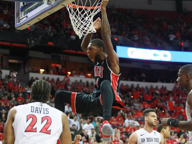 UNLV forward Roscoe Smith dunks on San Diego State during the first half of their Mountain West Conference semifinal game Friday, March 14, 2014 at the Thomas & Mack Center.