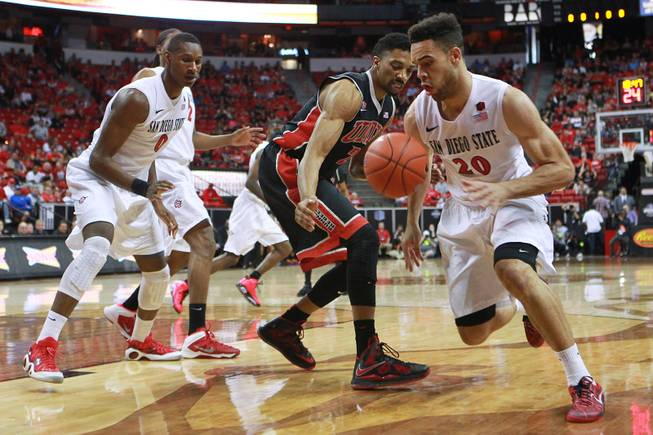 San Diego State forward J.J. O'Brien steals the ball from UNLV forward Khem Birch during the first half of their Mountain West Conference semifinal game Friday, March 14, 2014 at the Thomas & Mack Center.