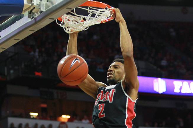 UNLV forward Khem Birch dunks on San Diego State during the first half of their Mountain West Conference semifinal game Friday, March 14, 2014 at the Thomas & Mack Center.