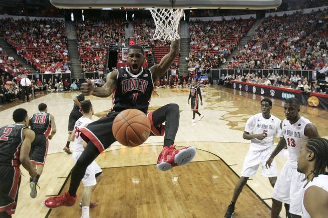 UNLV forward Roscoe Smith dunks on San Diego State during their Mountain West Conference semifinal game Friday, March 14, 2014, at the Thomas & Mack Center. The No. 8-ranked San Diego State Aztecs won 59-51 to advance to the finals.
