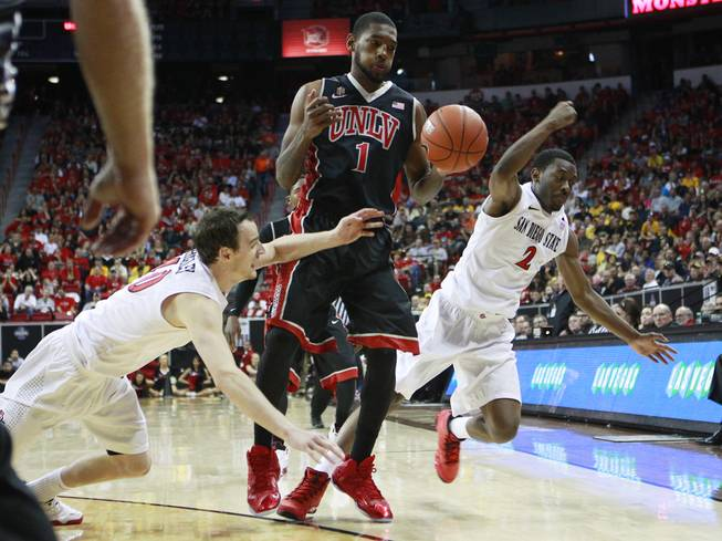 San Diego State forward Matt Shrigley knocks the ball out of UNLV forward Roscoe Smith's hands during their Mountain West Conference semifinal game Friday, March 14, 2014 at the Thomas & Mack Center. The #8 ranked San Diego State Aztecs won 59-51 to advance to the finals.