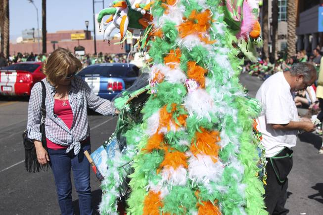 An attendee looks at a vendor's merchandise during the annual St. Patrick's Day parade in Henderson Saturday, March 15, 2014.