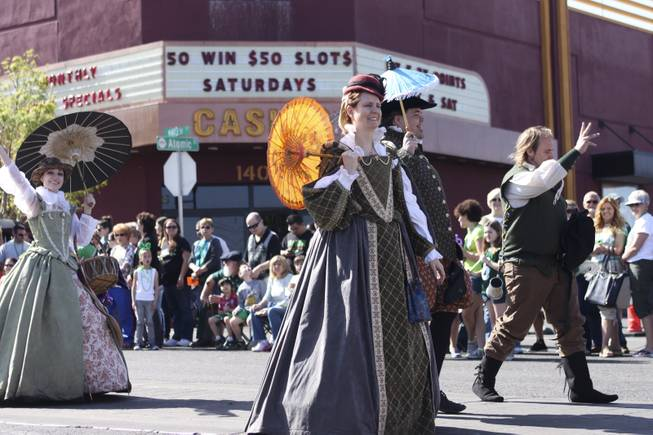 Members of the House of Stuart Reenactment Guild wave at the crowd during the annual St. Patrick's Day parade in Henderson Saturday, March 15, 2014.