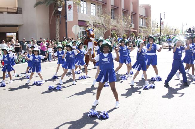 "The cheer club from Rose Warren Elementary school perform to Beyonce's ""Move Your Body"" during the annual St. Patrick's Day parade in Henderson Saturday, March 15, 2014."