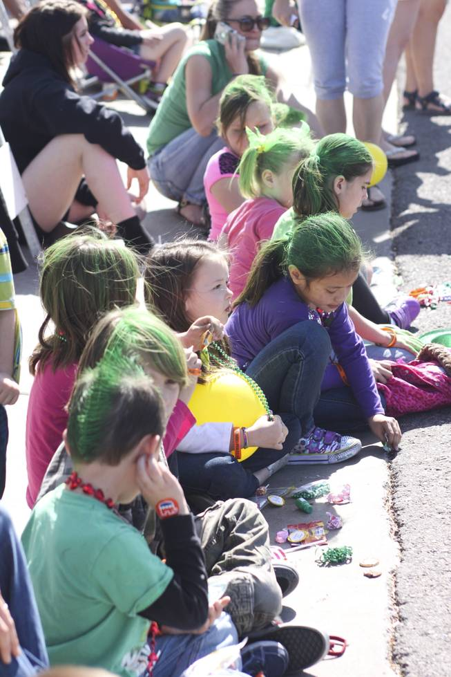 Children with their hair painted green look on during the annual St. Patrick's Day parade in Henderson Saturday, March 15, 2014.