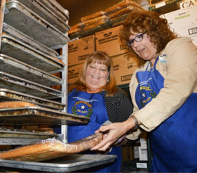 Misti Gower, left, and Heidi Englund check sheet cakes in the freezer at Carson Tahoe Regional Medical Center in Carson City as they prepare to put together the state's 150th anniversary cake. The cake, made of 170 sheet cakes, will be served on Friday, March 21, 2014.