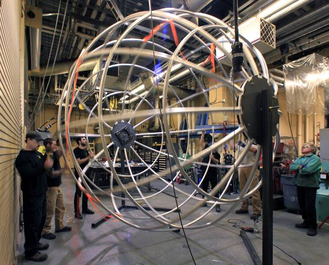 "Fabricators with ""One Night for One Drop"" prepare their completed Earth Globe for transport while continuing work of the bedroom set props Thursday, March 13, 2014, for the upcoming show at Michael Jackson One Theater at Mandalay Bay. The one-night-only performance is March 21."