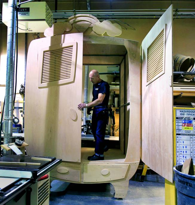 "Structural fabricator Richard Anderson with ""One Night for One Drop"" continues his work on a bulging, oversized wardrobe Tuesday, March 11, 2014, as part of a bedroom set for the March 21 benefit show."