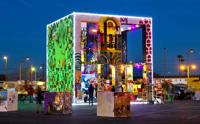 The Life Cube project in downtown Las Vegas is a walk-thru, interactive experience, with murals from local artists, write boards and dramatic lighting at night on Friday, March 14, 2014.