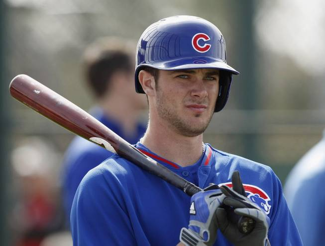 In this Feb. 21, 2014 file photo, Chicago Cubs third baseman Kris Bryant prepares to take batting practice during spring training baseball practice in Mesa, Ariz. Bryant, 22, is a big-time prospect.
