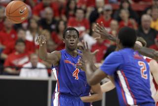 Boise State's Thomas Broplehpasses to his teammate Derrick Marks during the first half of an NCAA college basketball game against New Mexico in the semifinals of the Mountain West Conference men's tournament Friday, March 14, 2014, in Las Vegas. (AP Photo/Isaac Brekken)