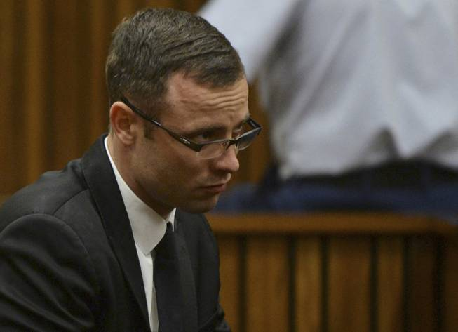 Oscar Pistorius sits in the dock during his murder trial at a court in Pretoria, South Africa, Friday, March 14, 2014. Pistorius is charged with the shooting death of his girlfriend Reeva Steenkamp, on Valentines Day in 2013.