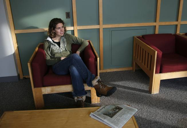 Freshman Lydia Collins, 19, chats with a friend in a lounge at Tufts University in Medford, Mass., on Thursday, March 13, 2014. Collins took off a year after high school and worked in Ecuador through Global Citizen.