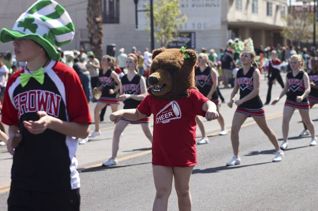 The Brown Junior High mascot performs with the cheer squad during the annual St. Patrick's Day parade in Henderson Saturday, March 15, 2014.