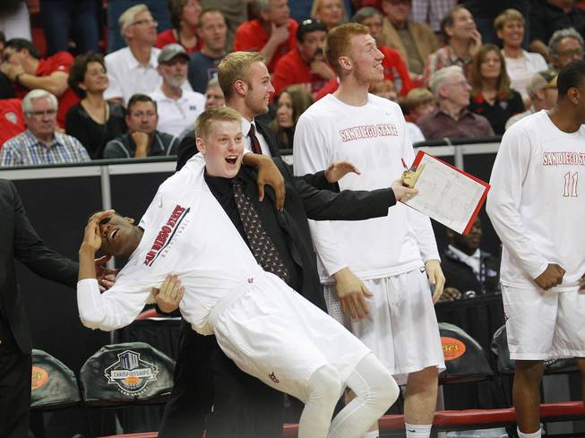 The San Diego State bench reacts as they pull even with New Mexico during their Mountain West Conference tournament championship game Saturday, March 15, 2014 at the Thomas & Mack Center. The Lobos won their third straight title, defeating the Lobos 64-58.