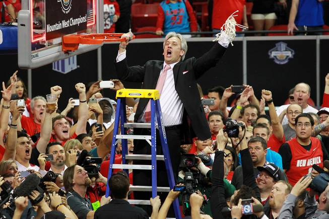 New Mexico head coach Craig Neal cuts down the net after the Lobos defeated San Diego State 64-58 in the  Mountain West Conference tournament championship game Saturday, March 15, 2014 at the Thomas & Mack Center.