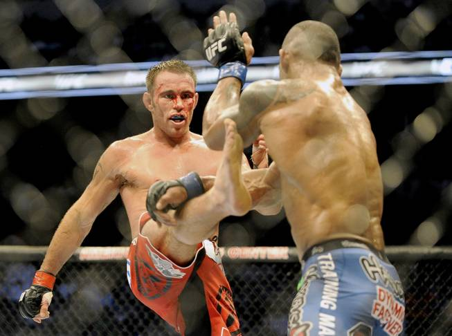 Jake Shields, left, tries to land a kick on Hector Lombard during a UFC 171 mixed martial arts welterweight bout on Saturday, March. 15, 2014, in Dallas. Lombard won by decision.