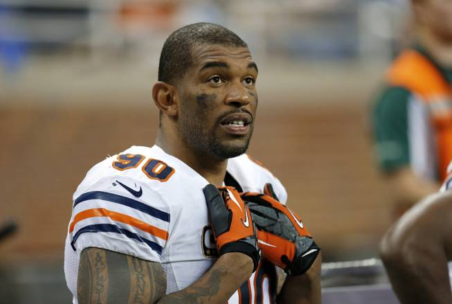 In this Sept. 29, 2013, file photo, Chicago Bears defensive end Julius Peppers watches from the bench during the fourth quarter of an NFL football game against the Detroit Lions in Detroit. The Bears released eight-time Pro Bowl defensive end Peppers, and he signed with the Green Bay Packers.