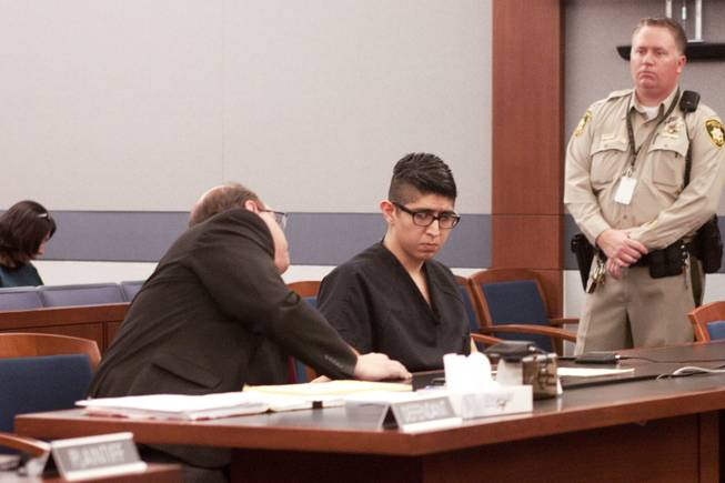 Cristian Diaz listens to his lawyer during his sentencing hearing Monday, March 17, 2014. Diaz, 20, pleaded guilty last year to two counts of driving while under the influence of a controlled substance causing death and substantial bodily harm.