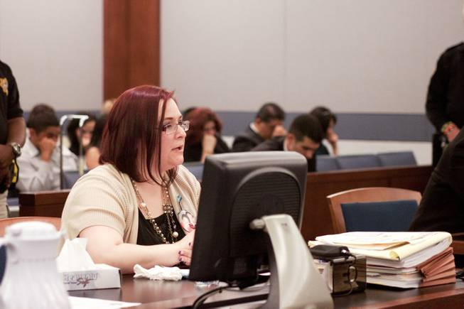 Crystal Hill, mother of victim Jesse Hill who was hit by driver Cristian Diaz while walking with his girlfriend and subsequently died, addresses District Court Judge Jerome Tao during Diaz' sentencing hearing Monday, March 17, 2014. Diaz, 20, pleaded guilty last year to two counts of driving while under the influence of a controlled substance causing death and substantial bodily harm.