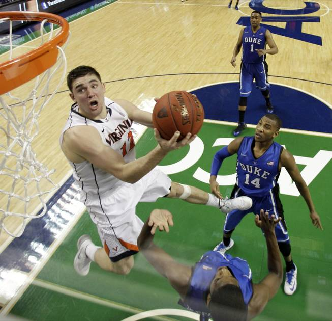 Virginia's Joe Harris goes to the basket against Duke in the second half of an NCAA college basketball game in the championship of the Atlantic Coast Conference tournament in Greensboro, N.C., Sunday, March 16, 2014. Virginia won 72-63. Harris was the tournament MVP.