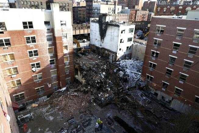 Rubble is seen Friday, March 14, 2014, two days after a natural gas explosion leveled two apartment buildings in New York. Using sound devices to probe for voices and telescopic cameras to peer into small spaces, workers searching a pile of rubble from a gas explosion in the East Harlem section of Manhattan continued to treat it as a rescue operation, holding onto the possibility of finding survivors from a blast that brought down two apartment buildings and killed at least eight people.