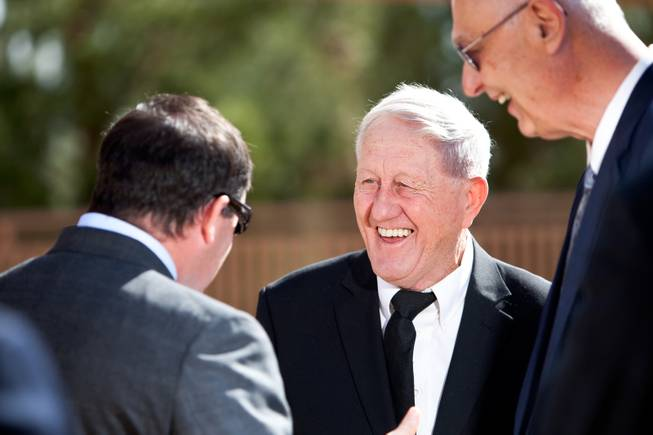 "Grandson Brendan Gaughan, from left, Bill Perrin and Tony Hegler laugh with each other while sharing stories about John Davis ""Jackie"" Gaughan during his memorial mass at St. Viator Catholic Church in Las Vegas on St. Patrick's Day, March 17, 2014."