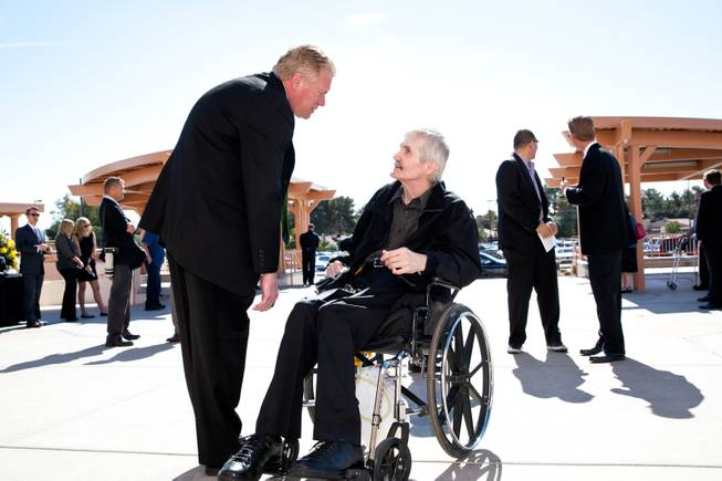 "Mike Nolan, left, greets former Raiders Super Bowl champion and quarterback David Humm, a long-time friend of Jackie Gaughan, during the memorial mass for John Davis ""Jackie"" Gaughan held at St. Viator Catholic Church in Las Vegas on St. Patrick's Day, March 17, 2014."