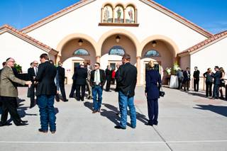 Long-time friends and family gather outside the sanctuary waiting to attend the memorial mass for John Davis