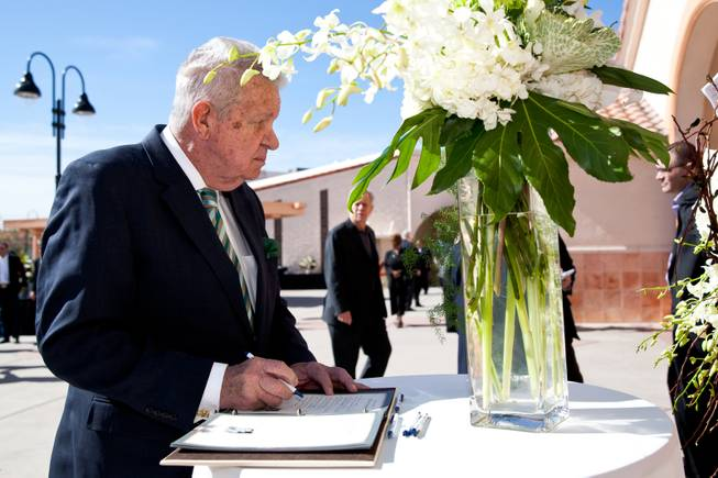 "Gene Kilroy signs the guestbook while attending the memorial mass for John Davis ""Jackie"" Gaughan held at St. Viator Catholic Church in Las Vegas on St. Patrick's Day, March 17, 2014."