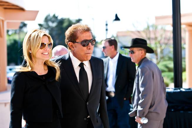 "Steve Wynn with his wife Andrea Hissom arrives for the memorial mass for John Davis ""Jackie"" Gaughan held at St. Viator Catholic Church in Las Vegas on St. Patrick's Day, March 17, 2014."