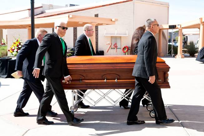 "Pallbearers carry the casket of John Davis ""Jackie"" Gaughan into St. Viator Catholic Church for a memorial mass in Las Vegas on St. Patrick's Day, March 17, 2014."