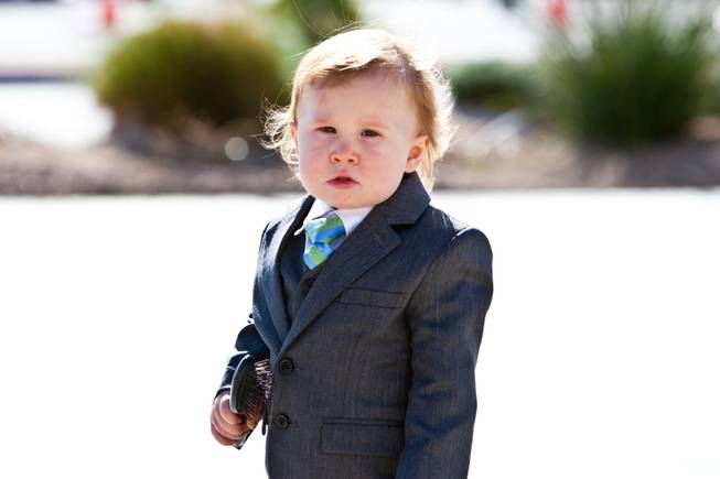 "John Davis ""Jackie"" Gaughan's youngest great grandson, 17-month-old Ryland Gaughan, looks for his mom while attending the memorial mass for his grandfather at St. Viator Catholic Church in Las Vegas on St. Patrick's Day, March 17, 2014."