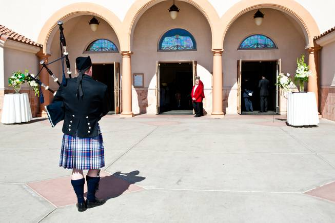 "Bag pipes continue to be played as the casket of John Davis ""Jackie"" Gaughan disappears into the sanctuary for the memorial mass held at St. Viator Catholic Church in Las Vegas on St. Patrick's Day, March 17, 2014.  Jackie Gaughan, 93, passed away March 12, 2014."